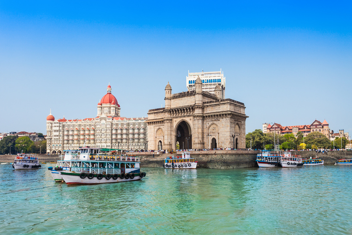 The Gateway of India and boats as seen from the Mumbai Harbour in Mumbai, India