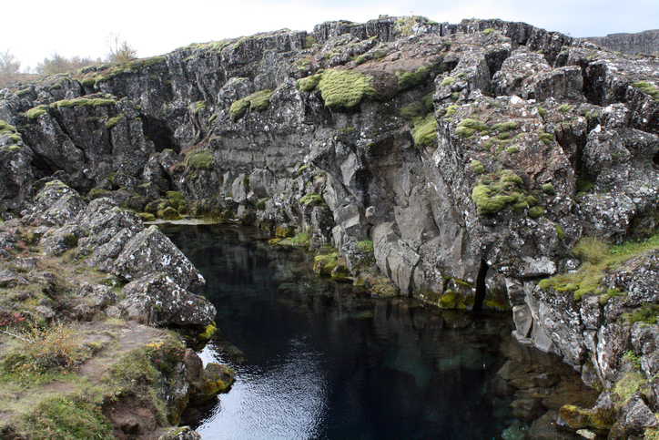Mossy volcanic landscapes at Thingvellir National Park in Iceland. Just outside Reykjavik, it is full of untouched rock formations, rivers and waterfalls.