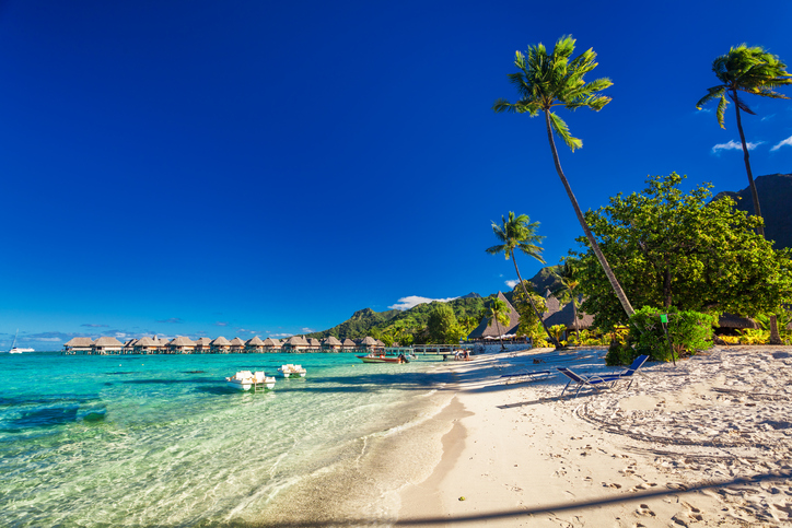 Tropical resort with sandy beach and palm trees on Moorea, French Polynesia