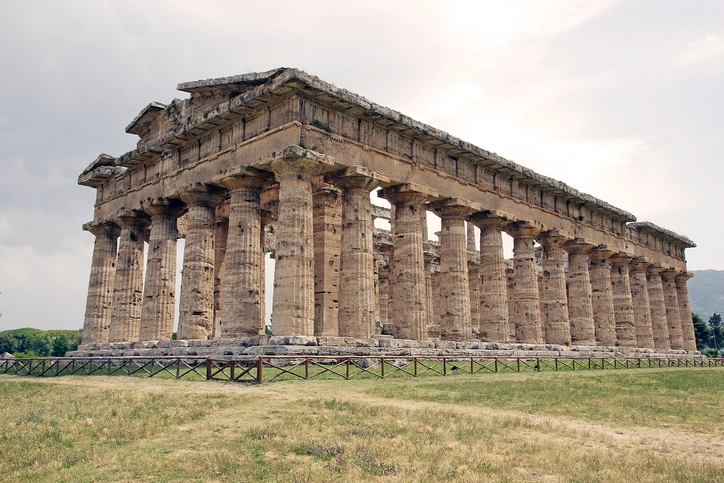 Paestum, Italy - June 16, 2016: Neptune temple or Poseidon temple or Second temple of Hera at Paestum, Italy. The temple was built around 450 BC by the Greek colonist. Eighteenth-century archaeologist nemed it the Basilica. Paestum was a major ancient Greek city on the coast of Tyrrhenian sea in Magna Grcia in southern Italy.