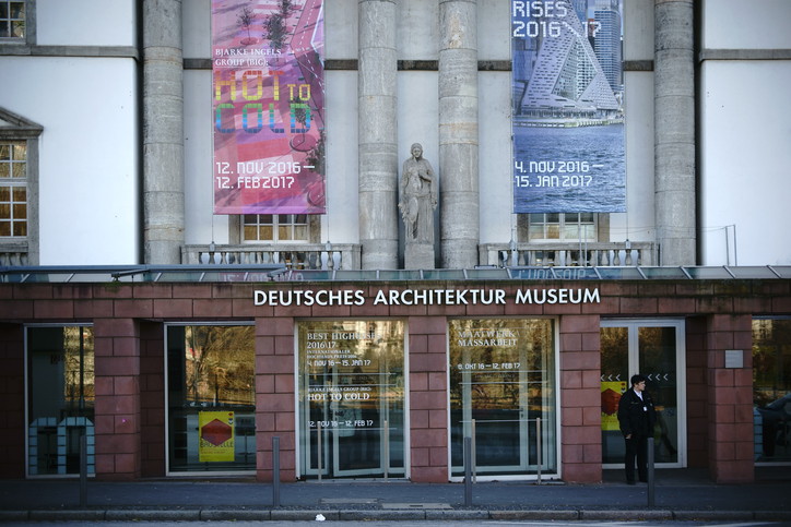 Frankfurt, Germany - January 05, 2017: An employee of the German Architecture Museum stands in front of the entrance at the Museum Shore on January 05, 2017 in Frankfurt.