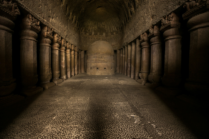 Mumbai, India - May 22, 2016: Ancient stone carvings and columns at the Kanheri caves site near Mumbai, India. The site dates back to the 10th century A.D. The Kanheri Caves demonstrate the Buddhist influence on the art and culture of India.