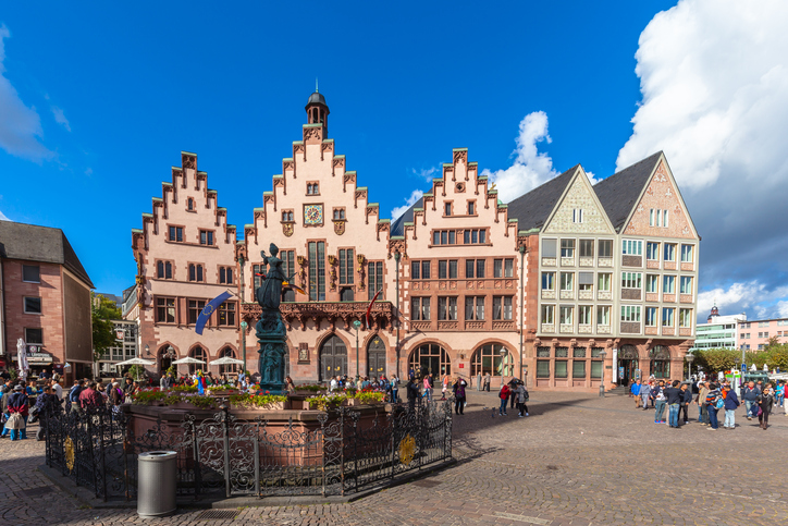 Frankfurt am Main, Germany - October 2, 2016 - Tourists at the Roemerberg square in front of the old city hall (Romer) of Franfurt am Main, Hesse, Germany