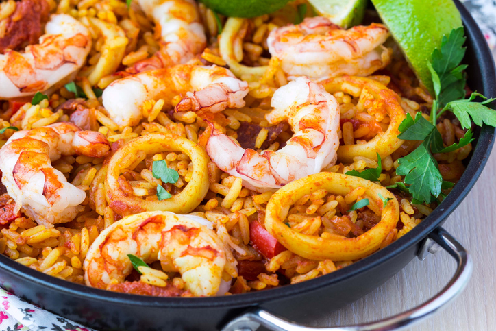 Spanish dish paella with seafood, shrimps, squid, rice, saffron, traditional tasty dinner
