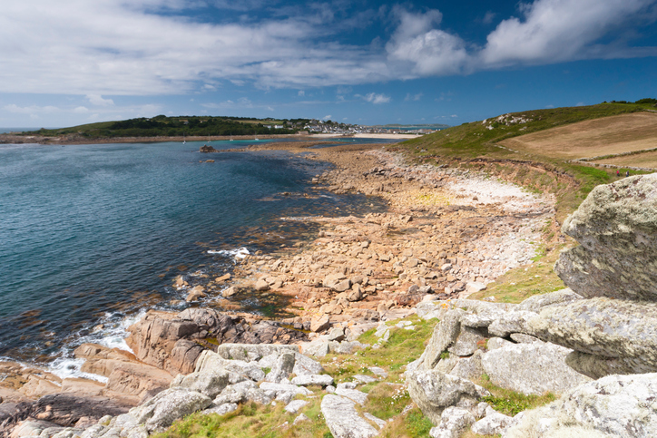 Taken in summer showing part of the lovely coastline of the Scilly Isles. In the distance is the town in St Mary's.