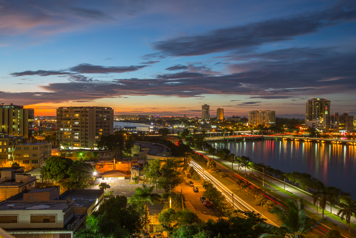 Vast and expansive view of the San Juan Bay, Condado Lagoon and the city of San Juan, Puerto Rico at sunset.