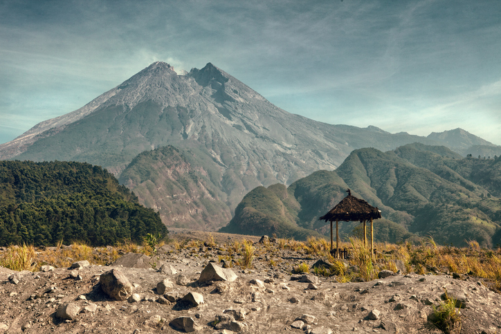 Mount Merapi,  is an active stratovolcano located on the border between Central Java and Yogyakarta, Indonesia. It is the most active volcano in Indonesia and has erupted regularly since 1548. It is located approximately 28 kilometres (17 mi) north of Yogyakarta city which has a population of 2.4 million, and thousands of people live on the flanks of the volcano, with villages as high as 1,700 metres (5,600 ft) above sea level.