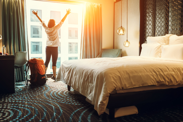 Happy backpacker traveller stay in high quality hotel