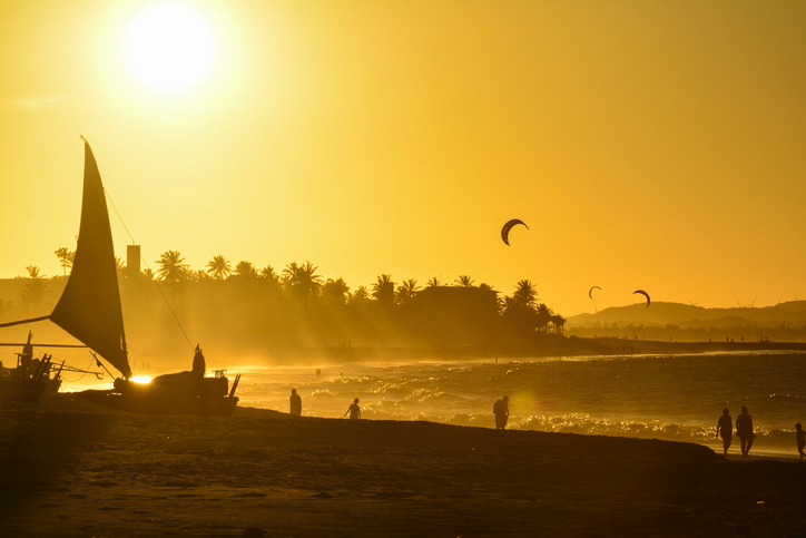Sunset at Cumbuco Beach. Kite surfers on the sea, Ceara State, Brazil