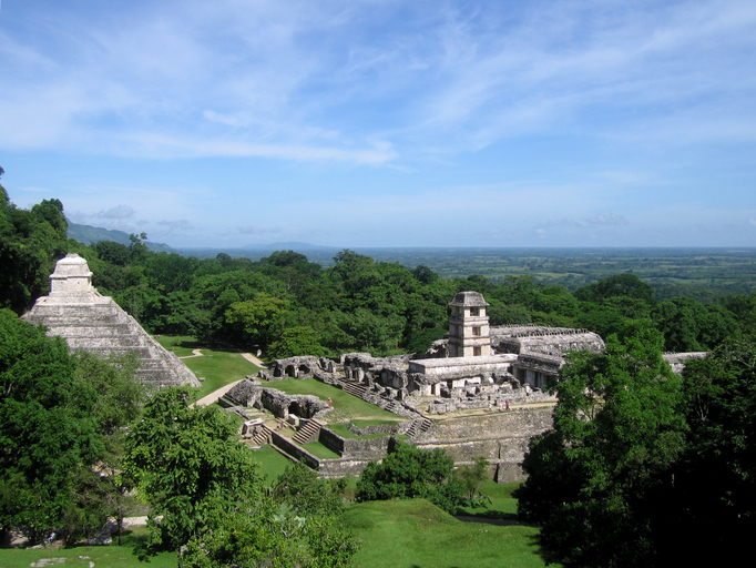 """""""View of the arquaeological site of Palenque, Chiapas, Mexico. Palenque was a very import Mayan city. Photo taken from the highest pyramid, the Temple of the Cross, showing the Temple of the Inscriptions (left) und the Palace with its observatory (right). The photo also shows the surrounding area - the Mayans always chose locations for their citys where they had the widest view."""""""