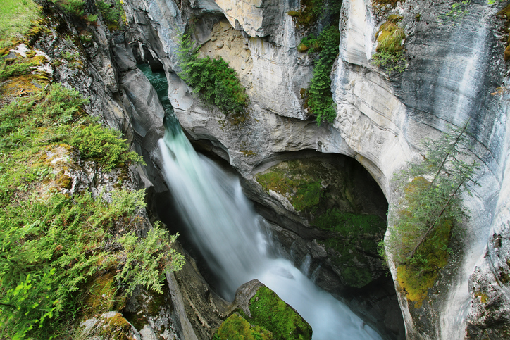 View of one of several Maligne Falls through the narrow Maligne Canyon in Jasper National Park, Alberta, Canada