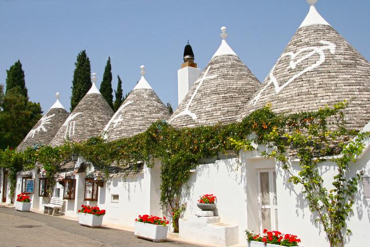 Row of trulli houses in the center of Alberobello, Puglia, Italy.