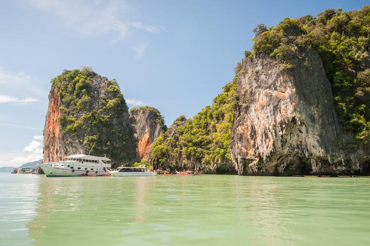 Yachts mored at island in Phang Nga Bay