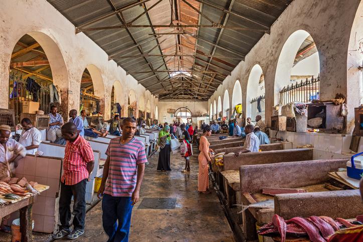 Stone Town, Zanzibar - October 24, 2014 : Sellers and buyers in the fish market in Zanzibar, Tanzania