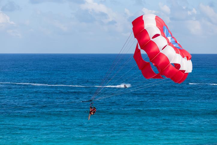 Cancun, Mexico - November 21, 2015: Parasailing above caribbean sea