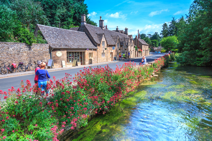 Bibury, United Kingdom - July 9, 2014: Ttraditional Cotswold stone cottages in Gloucestershire on JULY 9, 2014, England. Bibury it the most depicted village in the world.