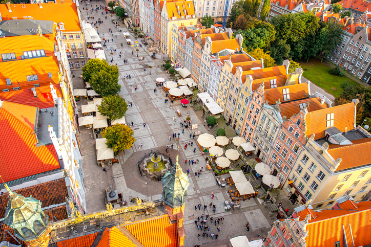 Aerial cityscape view on the market square with beautiful rooftops in the old town of Gdansk, Poland