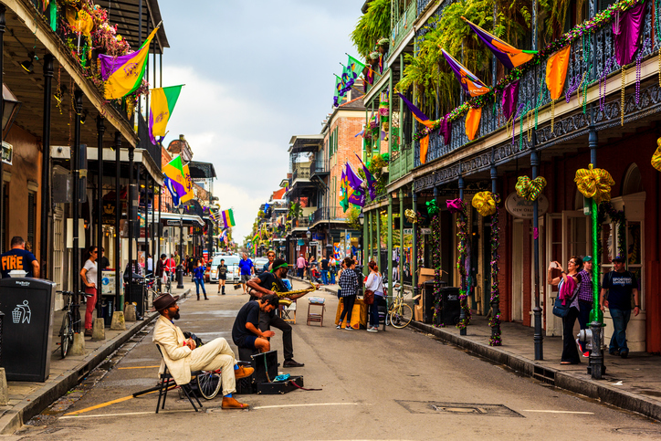 New Orleans USAFeb2 2016:Street musicians are all over in the French Quarter'sstreets of New Orleans. People arecelebrating and welcoming locals and visitors while enjoying the music.Thisisan ongoingstyle ofcelebration. There are a lot of talented artists in the city