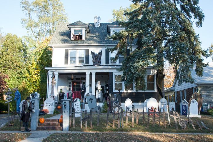 WOODBRIDGE, NEW JERSEY - October 26, 2013: A house is all decked out for Halloween with just about every spooky thing you could think of.