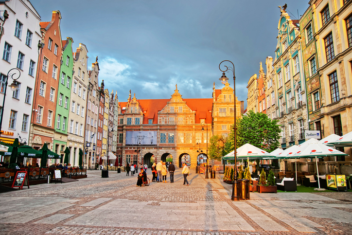 Gdansk, Poland - May 7, 2014: Green gate at Long Market Square in Gdansk, Poland. People on the background