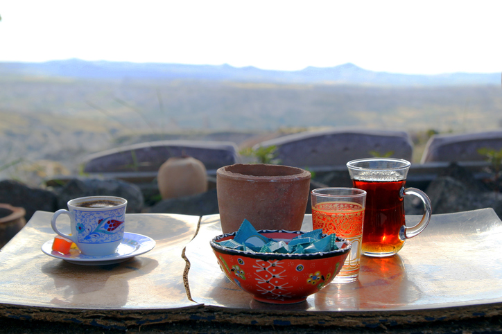 Travel to Cappadocia, Turkey. The cup of turkish tea and coffee on the wooden table in the mountains.
