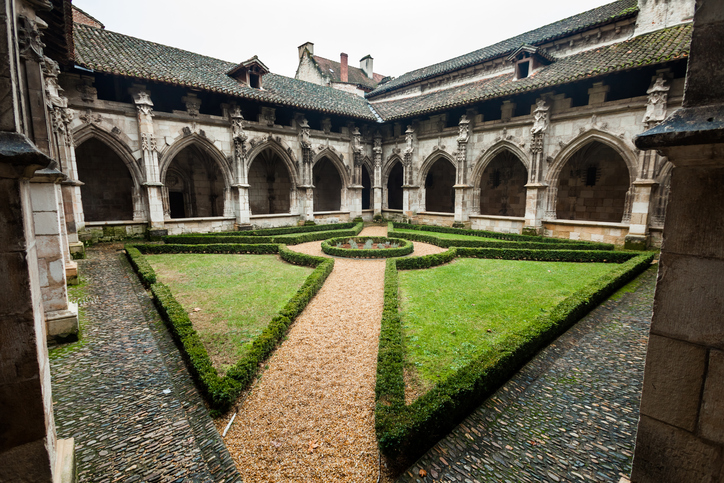 Cloister interior courtyard with grass in Cahors cathedral in France