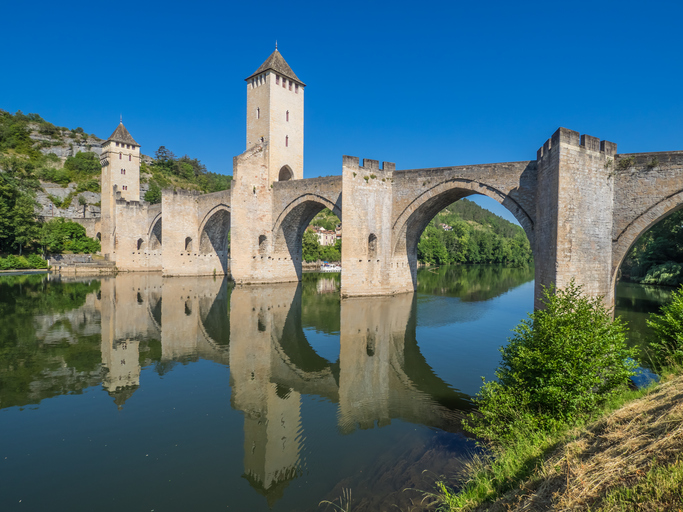 The Pont Valentre  is a 14th-century six-span fortified stone arch bridge crossing the Lot River to the west of Cahors, in France. It has become a symbol of the city.