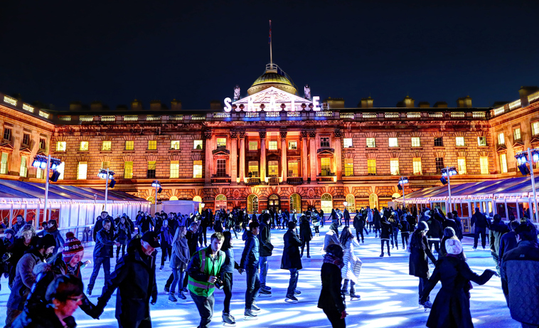 London, United Kingdom - November 22, 2012: People skating on a crowded ice skating rink in Somerset House in the evening.