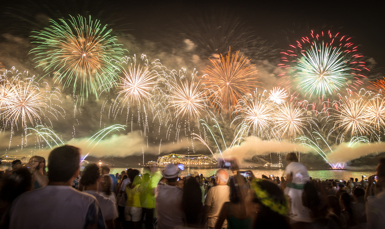 New Year's celebration in Copacabana, Rio de Janeiro, during the world famous fifteen minutes fireworks burning.