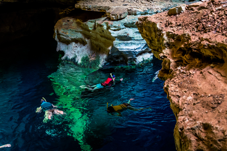 Chapada Diamantina, Bahia, Brazil - September 24, 2015: People snorkelling in Blue Pool, a flooded limestone cave located in the National Park of Chapala Diamantina