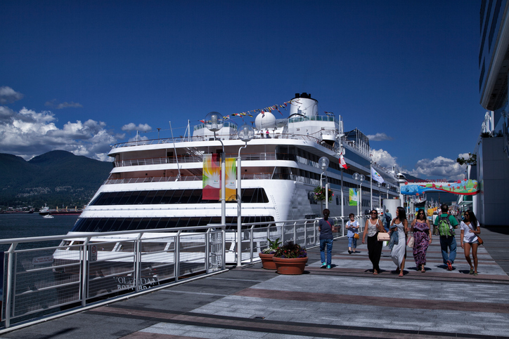 Vancouver, Canada - June 25, 2014: cruise ship MS Volendam seen docked at Canada Place, while many people walking by on the port, on a sunny summer afternoon.