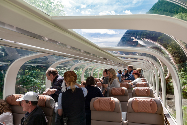 Vancouver, British Columbia, Canada - June 2, 2016: Hostess serves guests on the luxurious Rocky Mountaineer train as it makes its way from Vancouver to Kamloops