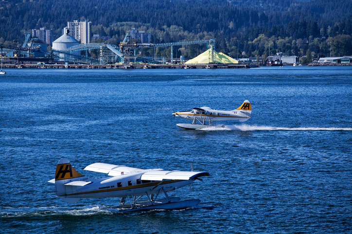 Vancouver, Canada - April 30, 2014: Two sea planes at Vancouver harbour, sulfur terminal in the background.