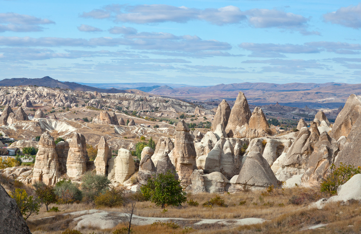 Unique geological formations in Cappadocia, Central Anatolia, Turkey. Cappadocian Region with its valley, canyon, hills located between the volcanic mountains Erciyes, Melendiz and Hasan.