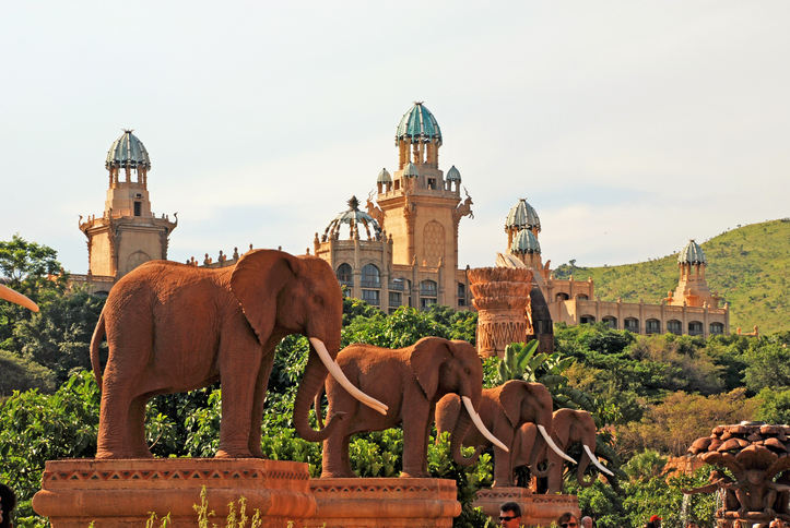 Gigantic elephant statues on Bridge of Time in famous resort Lost City in Sun City, South Africa.