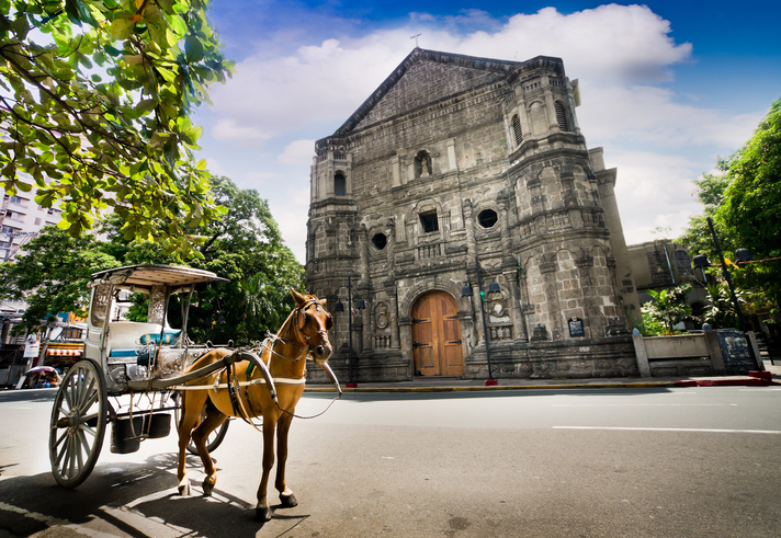 Horse Drawn Carriage parking in front of Malate church , Manila Philippines. The church is a Baroque-style church  was first built in 1588.
