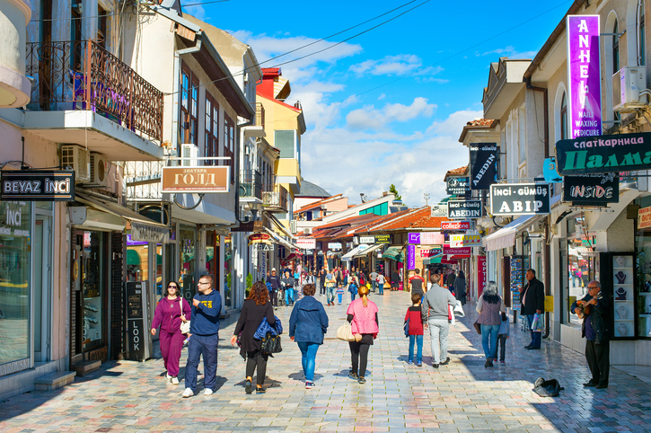 OHRID, MACEDONIA - OCTOBER 26, 2016: People walking on the main shopping boulevard in the historical center of Ohrid town. Ohrid - is the most famous tourist destination in Macedonia