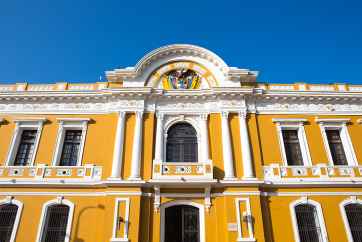 Yellow and white City Hall of Santa Marta with a blue sky, Colombia