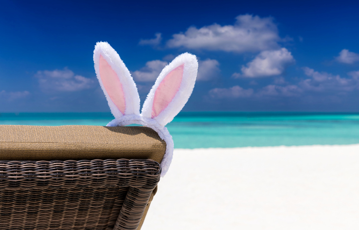 Easter bunny ears on sun chair at a tropical beach setting in the Maldives