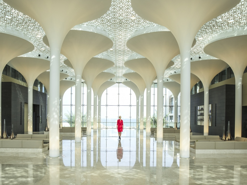 kempinski-hotel-muscat-lobby-interior-with-lady-in-red