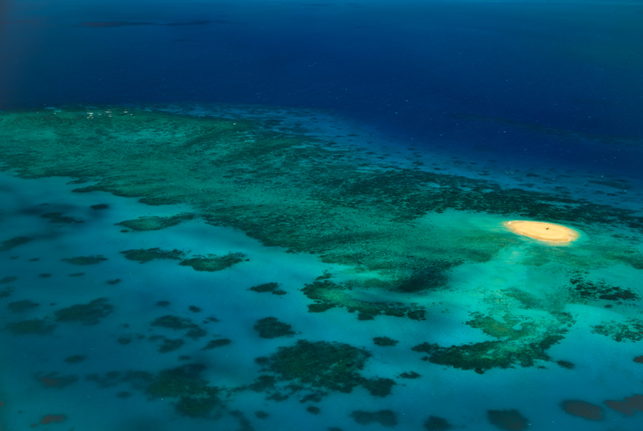 Upolu Cay Island in the Great Barrier Reef Marine Park Australia highlighted among the individual reefs underwater