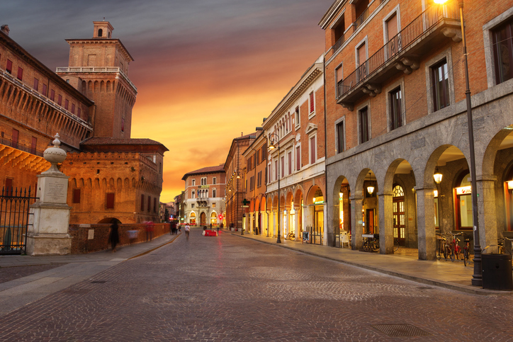 Ferrara, Italy - September 7, 2016: One of the famous streets of Ferrara. People love to walk here.