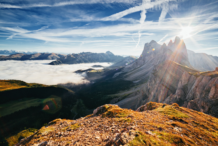 Aerial view of the alpine valley in sunlight. Great and gorgeous morning scene. Location place Puez-Odle National Park, Gardena, Seceda peak, Geisler Dolomiti group. Tyrol, Italy, Europe. Beauty world
