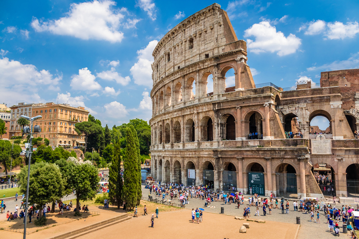 Colosseum with clear blue sky and clouds, Rome. Panorama