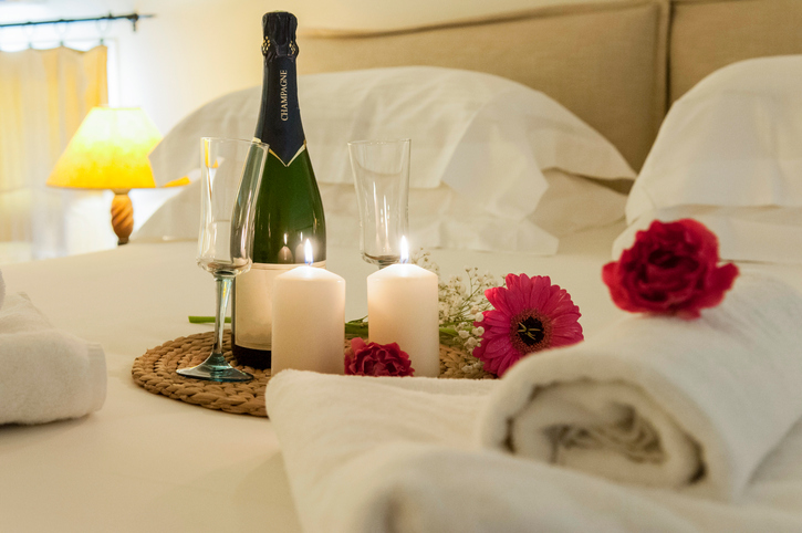 romance in bed with champagne