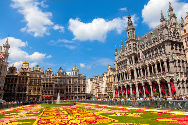 """Brussels, Belgium - August 14, 2010: Every two years thousands of visitors come to see the floral carpet on the famous Grand Place square. The floral composition takes over 2,000 square meters and almost 800,000 begonias have been used."""