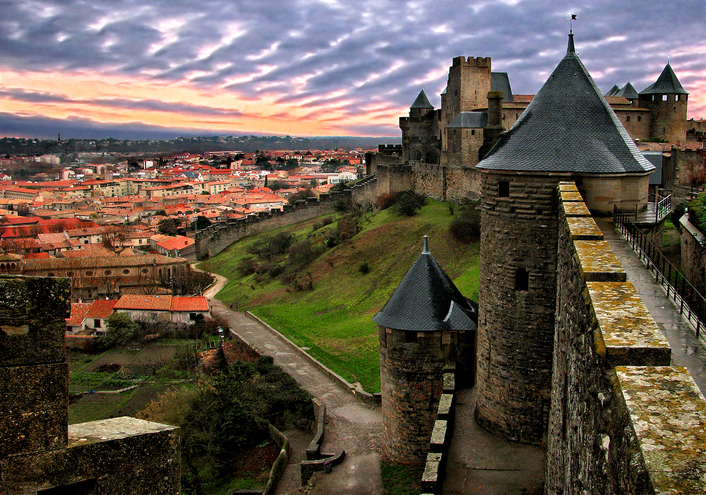 Carcassonne is a fortified French town in the Aude department, of which it is the prefecture, in the former province of Languedoc.