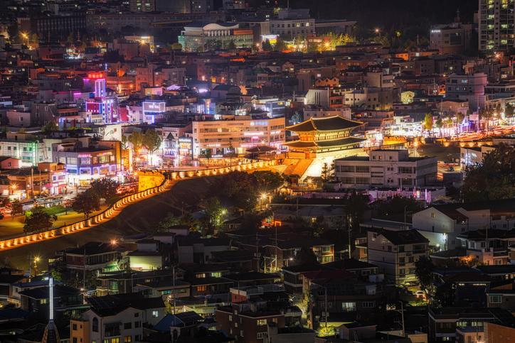 Hwaseong Fortress and Suwon city at night, South Korea.