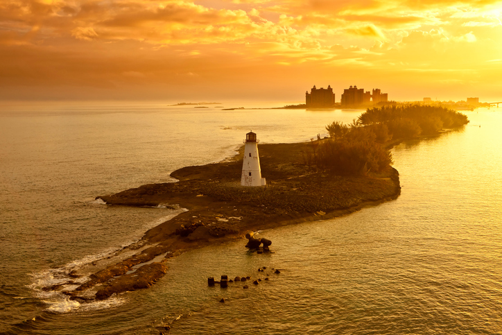 lighthouse and resort on nassau, bahamas at dawn