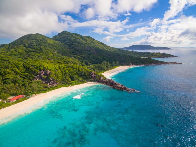 Aerial shot of beautiful coastline and beaches of tropical La Digue Island, Seychelles.